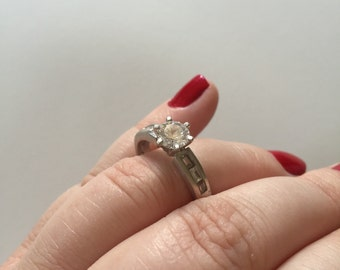 Vintage Round Cut and Baguette White Cubic Zirconia 925 Sterling Silver Engagement Style Ring