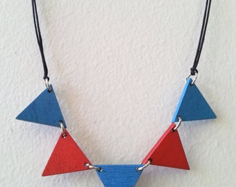 Geometric triangle bunting necklace, with little red and blue wooden triangles 20x17mm, black matte nylon cord and lobster clasp