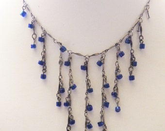 Nice old necklace, drapery with blue glass beads