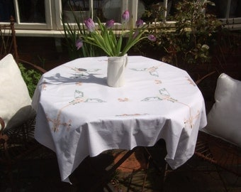 A gorgeous vintage hand embroidered table cloth from the 1940s