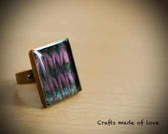 Green and purple square ring