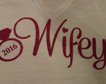 Wifey iron-on decal-decal Only. Great for New brides. Fun shirt for your honeymoon! Use on shirts, bags etc.  Hubby shirts available too.