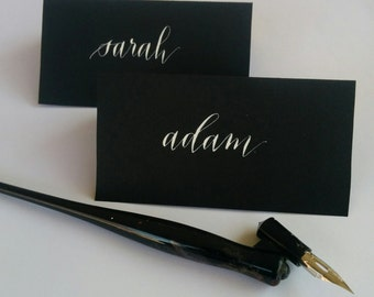Hand written place cards.  Made to order. Black card stock with white ink in modern calligraphy script.