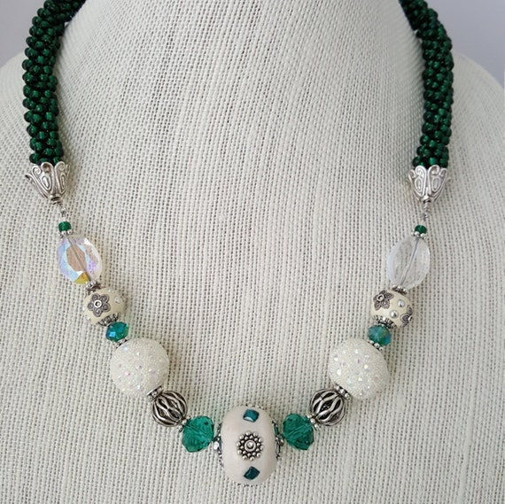 Green and white beaded kumihimo woven necklace