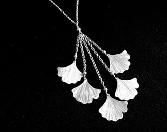 Silver gingko necklace with falling leaves