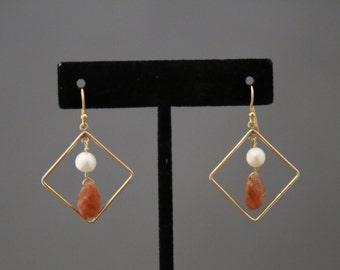 Sunstone and Pearl Dangle Earrings in Gold Diamond Frame