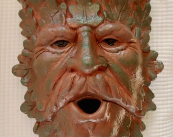 Terracotta Greenman Sconce sponged with green matte glaze
