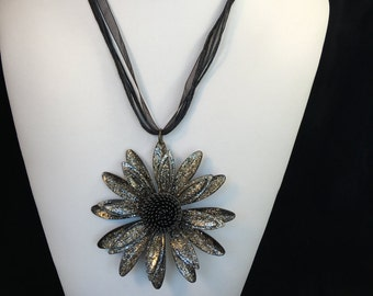 This is one big sparkly flower necklace