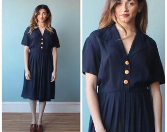 1940s navy rayon dress / short sleeve day dress / 1940s / medium