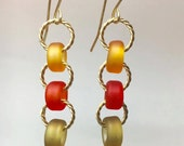Sea glass style lampwork autumn colors earrings with gold braided wire accents, hand made glass tawny ambers, burnt orange and gold green