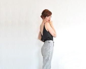 high waist acid washed jeans . gray black denim . stirrups and everything .medium .sale