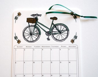 2017 Wall Calendar, 5.5x8.5 inches featuring 12 different illustrations in green, gold, mustard, pink, gray, mauve and brown