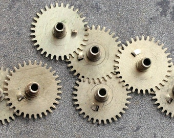 Vintage clock brass gears -- set of 12 -- D8