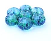 Handmade emerald lampwork beads - set of 7 green frizzle glass beads