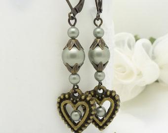 Sage green pearl earrings, Beaded jewelry, Vintage style antique bronze heart earrings, long green pearl dangle earrings