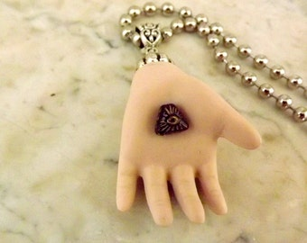 The Eye of Providence Necklace:  Bisque, Porcelain, vintage doll hand, Avant Garde, Doll, hand, Eye,  necklace