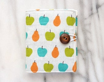 Apple and pear print needle book with brown button closure and felt pages