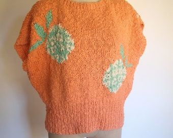 vintage 80s orange knit sweater top with buttons on the sleeve and pineapples