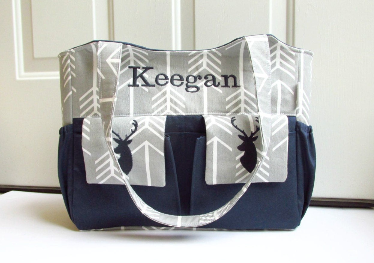 Personalized diaper bag in gray arrows and navy blue with