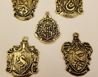 Bronze colored Hogwarts house crests needle minders, magnets, Harry Potter