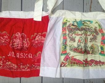 Lot of 2 Vintage Aprons Alaska Travel Souvenir Eskimo Igloo Yukon Mod Neon & Red