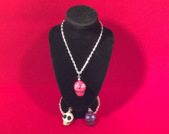 Handmade skull necklace in white, pink or purple.