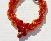 Bracelet orange, red and gold glass seed beads. Tibetan silver toggle clasp. Handmade gift