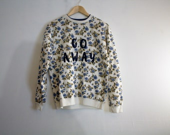 Go Away floral print crew neck sweater