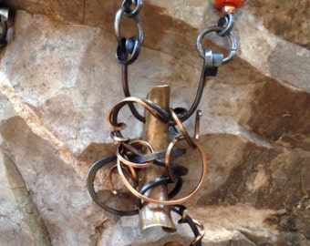 Pendant of brass, copper and steel