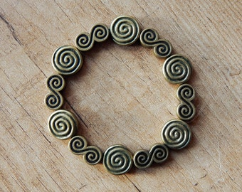"Swirls beaded elastic bracelet ""Madre"" in bronze tone"