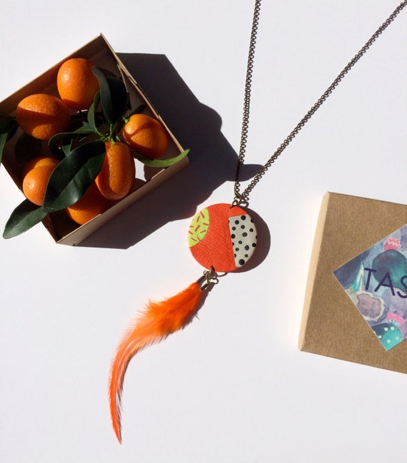 Orange festive pendant in bright tangerine leather with an '80s twist and a rooster feather/ Graphic leather pendant with dots and stripes