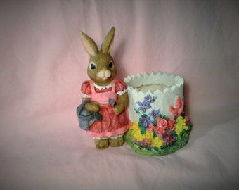 Easter Bunny Candle Holder - Girl Bunny in Pink Dress - Candle Sits inside a White Picket Fence, Colorful Flowers Line Base