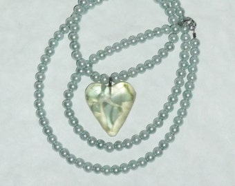 "Heart shaped necklace made with ""It's a Mad, Mad, Mad, Mad World"" car glass."