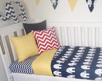 Yellow and navy elephant nursery set items