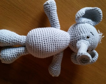 Crochet elephant with baby bootees and shoes