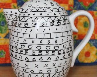 Hand drawn tall white porcelain teapot with monochrome aztec pattern