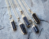 Raw black tourmaline necklace // geode necklace // black gemstone // black pendant // gold edged necklace