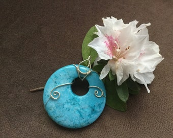 Wire wrapped turquoise/blue stone pendant
