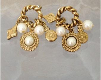Gold tone circular pierced earrings with pearl dangles