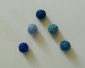 Magnets in blue felted wool balls
