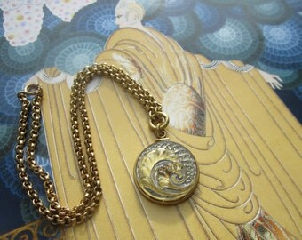 Gold And Silver Curled Feather Glass Pendant Necklace