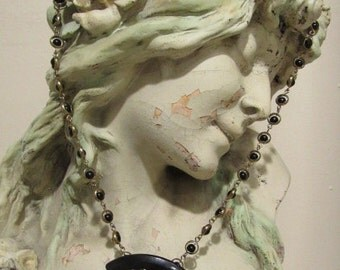 Assemblage Necklace with Damascene Brooch and Bakelite Stye Buckle on Bead and Gold Tone Chain