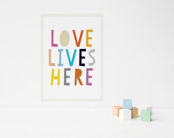 "Fabric wall decal poster. ""Love lives here"""