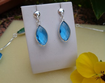 Earrings, sterling silver, with bright blue topaz (Hydro)