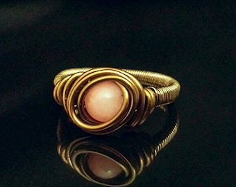 Pink jade gemstone ring wrapped with antique brass wire