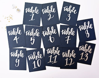 silver calligraphy wedding table numbers // handwritten in calligraphy font for wedding guest table signs // holiday wedding decor