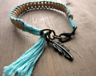 Bracelet of wooden beads, wires and charm pen antique bronze