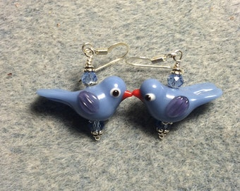 Opaque light blue lampwork songbird bead earrings adorned with light blue Chinese crystal beads.
