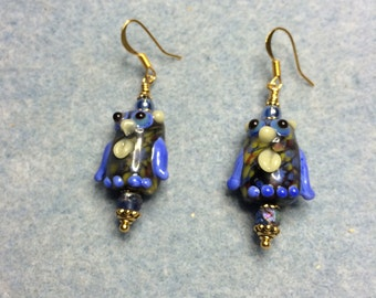 Blue and yellow lampwork owl bead earrings adorned with blue Czech glass beads.