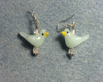 Milky off white lampwork songbird bead earrings adorned with clear Czech glass beads.